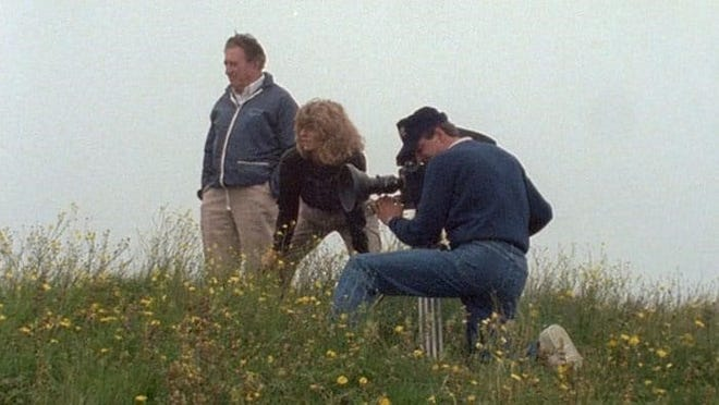 """Director Terry Strauss (center) spent three decades making """"As If They Were Angels,"""" a documentary about a little-known story about the loss and rescue of U.S. sailors off the coast of Newfoundland. This image shows the director shooting 16mm film in Newfoundland in 1988. (Photo courtesy of Terry Strauss)"""