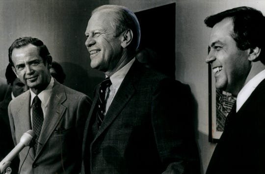 (L-R) Gov. William Milliken, former president Gerald Ford and Vic Caputo speak during a press conference at city airport in 1980.