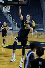 Freshman Franz Wagner does a layup at practice after Michigan basketball media day Thursday at Crisler Center