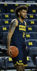 Michigan forward Isaiah Livers listens to the instructions for a drill at practice Thursday at Crisler Center.