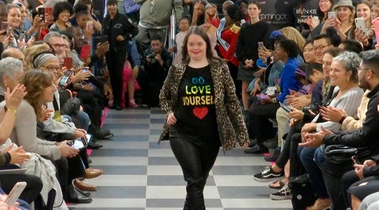 """This image from video taken on Wednesday, Oct. 16, 2019 shows a girl participating in the 2nd annual """"Gigi's Playhouse Fashion Show"""" in New York."""