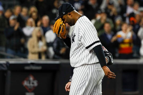 Yankees pitcher CC Sabathia is helped off the field during the eighth inning in Game 4 of the ALCS on Thursday.