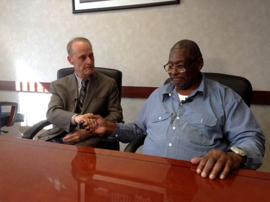 Charles Lewis (right) meets with his attorney Sanford Schulman.