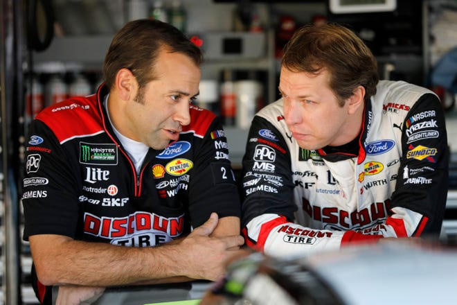 Rochester Hills' Brad Keselowski, right, talks with crew chief Paul Wolfe during practice Friday.