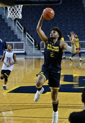 Michigan forward Isaiah Livers goes to the basket at practice.