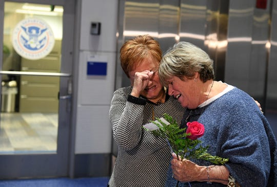 Jackie Murphy, 80, left, of Macomb Township, and her sister, Suzan Baekkelund, 76, of Nashville, are overcome with emotion as they meet face to face for the first time in 75 years Wednesday at Detroit Metropolitan Airport.