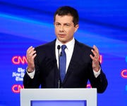 In this Oct. 15, 2019, photo, Democratic presidential candidate South Bend Mayor Pete Buttigieg speaks during a Democratic presidential primary debate hosted by CNN and The New York Times at Otterbein University in Westerville, Ohio.