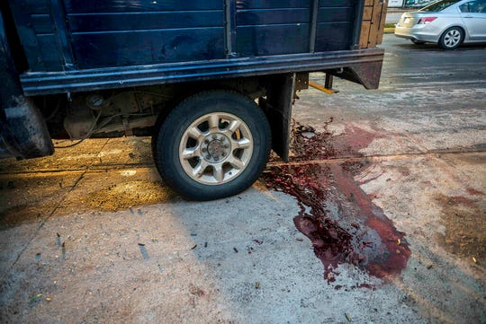 """Blood stains the street after a gunfight in Culiacan, Mexico, Thursday, Oct. 17, 2019. An intense gunfight with heavy weapons and burning vehicles blocking roads raged in the capital of Mexico's Sinaloa state Thursday after security forces located one of Joaquin """"El Chapo"""" Guzman's sons who is wanted in the U.S. on drug trafficking charges."""