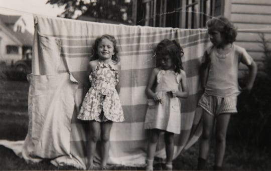 Suzan, left, was adopted and became Suzan Trotter, seen in 1949.