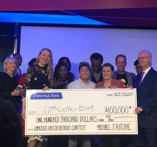 Drew Pineda, center, and Erin Pineda were awarded $100,000 for their small business, 27th Letter Books in Detroit, which they plan to open in the Jefferson-Chalmers neighborhood.