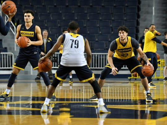 Michigan forward Brandon Johns Jr. (23) and wing Adrien Nunez, at left, are going to be relied upon more this season.