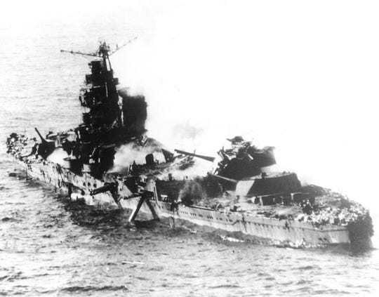In this May 1942 file photo a Japanese heavy cruiser of the Mogami class lies low in the water after being bombed by U.S. naval aircraft during the Battle of Midway.