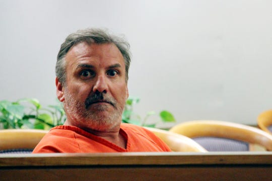 Brian Steven Smith looks out in the courtroom while waiting for his arraignment to start Wednesday, Oct. 16, 2019, in Anchorage, Alaska. A public defender entered not guilty pleas for Smith, who is accused of documenting the assault and murder of Kathleen Henry in an Anchorage hotel.
