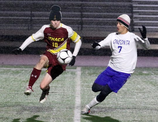 Flynn McCarthy of Ithaca controls the ball as Oneonta's EJ Kavrazonis defends during Ithaca's 1-0 win in the STAC boys soccer championship game Oct. 17, 2019 at Ithaca High School.
