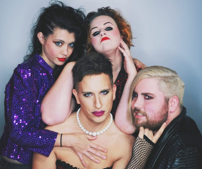 Rocky Horror Picture Show main character Frank-n-Furter, played by Raymond Sartler, poses at center, surrounded by members of his entourage. Clockwise, from left, are Mackenzie Gens as Columbia, Liz Wustrack as Magenta and Nicholas Lamers as Riff Raff.