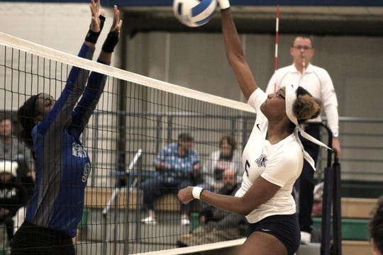 Terra State Community College middle blocker Maria Singleton powers the ball over the net during the Titans' match against visiting Henry Ford College Thursday evening. Terra State won the match in three sets to improve to 9-10 on the season.