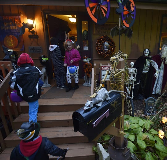 Trick-or-treaters visit a spooky house on North Fifth Avenue in Sturgeon Bay during a past Halloween.