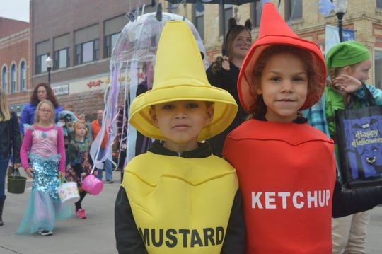 """We're not sure we can resist the temptation to note how these two young trick-or-treaters were able to """"mustard"""" the strength to """"ketchup"""" to the rest in last year's costume parade during the """"Thrills in Third"""" Halloween celebration in Sturgeon Bay."""