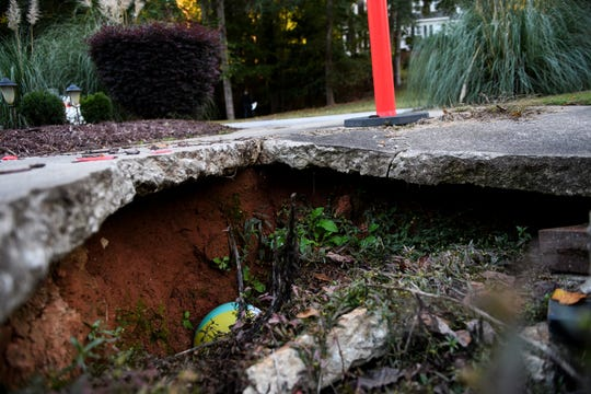 A large sinkhole is visible in the middle of Russ Maio's driveway at his Mauldin home Thursday, Oct. 17 ,2019.