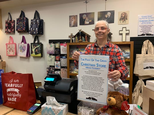 Letha Davis holding the mission of The Foot of the Cross Christian Store
