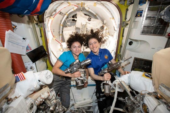Astronauts Jessica Meir, left, and Christina Koch pose for a photo Oct. 17 in the International Space Station.