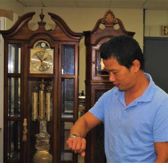 Anthony Nguyen presides over a Dededo Mall clock and watch repair shop.