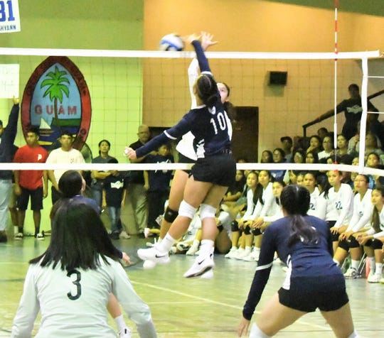 Girls volleyball semifinal playoff action between perennial rivals the Notre Dame Royals and Academy of Our Lady of Guam Cougars. The teams were even after the first two sets, but the two-time defending champion Royals won the next two for a 3-1 win and a berth in the championship game on Oct. 22 at UOG. They will again face the St. John's Knights, who upset the JFK Islanders 3-2 Oct. 18 at JFK.