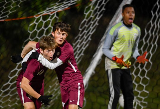 Henderson County's Wes Tompkins (2) congratulates teammate Bryce Bennett (18) after a first period goal as the Henderson County Colonels play the Hopkinsville Tigers in the second round of the boys regional soccer tournament at Henderson's Colonel Field Wednesday evening, October 17, 2019.