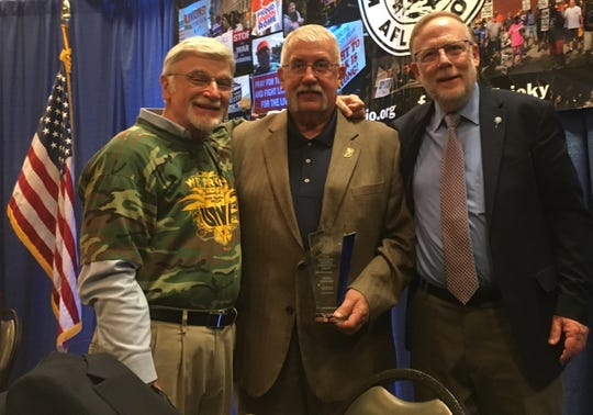 After receiving his Lewis Hicks Lifetime Achievement Award, John Coomes of Henderson (center) poses with International UMWA President Cecil Roberts (left) and Kentucky AFL-CIO President Bill Londrigan.