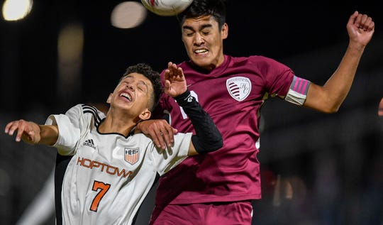 Henderson County's David Gonzalez (10) heads the ball ofter Hopkinsville's Josh Hermosillo (7) as the Henderson County Colonels play the Hopkinsville Tigers in the second round of the boys regional soccer tournament at Henderson's Colonel Field Wednesday evening, October 17, 2019.