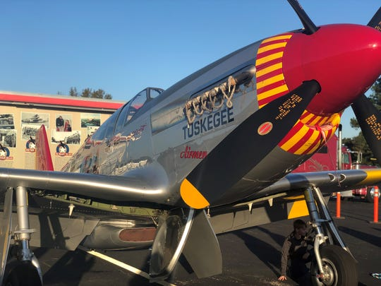 A restored World War II-era P-51C Mustang, the signature aircraft used by the Tuskegee Airmen, was on display as part of a traveling exhibit at the Humboldt airport.