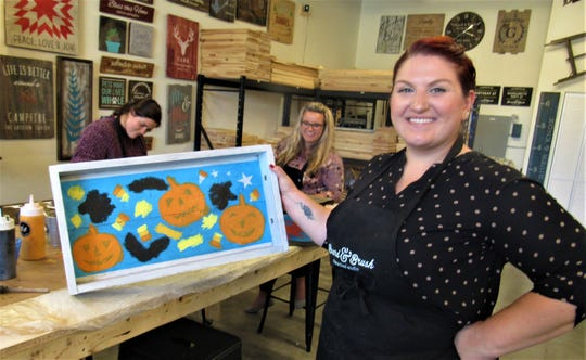 "Michelle McCrory completed a Halloween trick-or-treat tray at Board & Brush on Oct. 16, 2019.  ""This was my first time here.  It was fun and easy, and I can use this tray for years to come,"" she said."