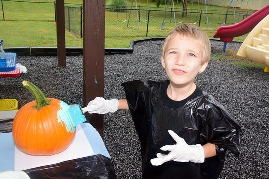 Nathan Metz, 7, paints a pumpkin teal in honor of the Teal Pumpkin Project at Beaver Ridge United Methodist Church Saturday, Oct. 12. Photos