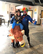 The first customers at the beginning of the inaugural South Knoxville Halloween Crawl at Printshop Beer Co. Oct. 27, 2018. This year's event will be held at eight different South Knoxville locations all day on Oct. 26.