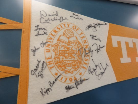 UT pennant on display in Western Plaza Barber Shop signed by members of Phillip Fulmer's first coaching staff.