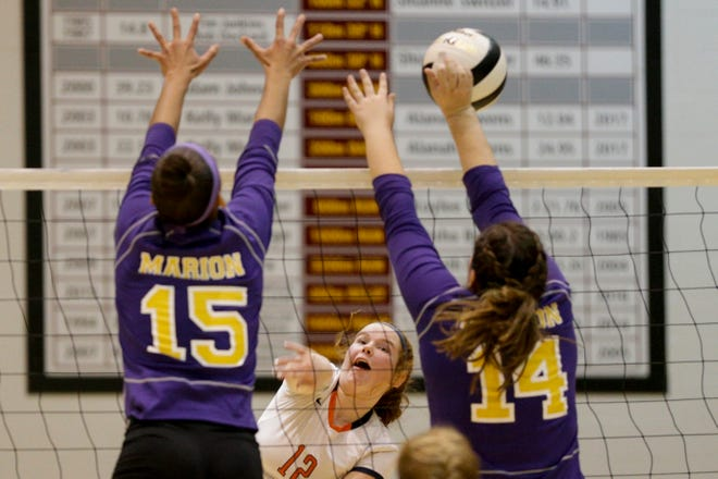 Harrison's Sonja Geddes (12) spikes the ball during the second set of an IHSAA girls volleyball sectional match, Thursday, Oct. 17, 2019 in Lafayette. Harrison won, 3-0 (25-17, 25-19, 25-23).
