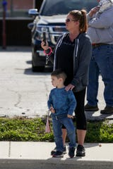 "Jodi Maddox places her hand on her grandson, Gunner Maddox, 4, shoulder during the funeral procession for Indiana State Police Trooper Peter ""Bo"" Stephan, Friday, Oct. 18, 2019 in Russiaville. Trooper Stephan died Friday, Oct. 11, in a single-car crash."