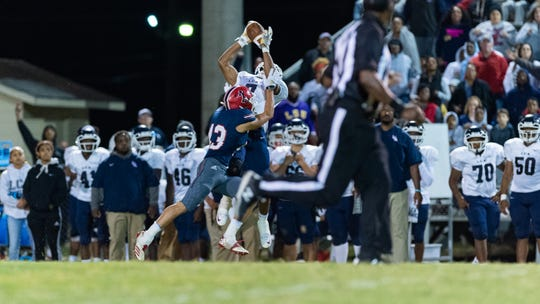 Lafayette Christian Academy's Errol Rogers Jr., who signed Wednesday with UL as a receiver, goes up high to pull in a pass against Notre Dame High in October.