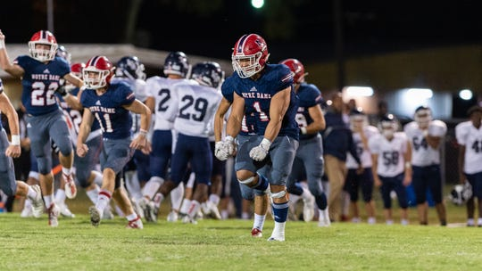 Joe Pommier celebrates after making an interception as Notre Dame takes on LCA football, Thursday, Oct. 17, 2019.
