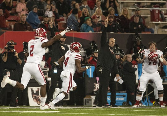 Raymond Calais runs 80 yards for a touchdown in the first half of Thursday's football game between the Ragin' Cajuns and Arkansas State.