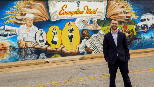 Local artist Dirk Guidry presented his mural in honor of Evangeline Maid Breads 100 years of business.