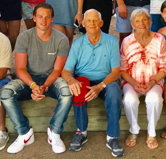 LSU quarterback Joe Burrow sits with his grandfather James Burrow and grandmother Dot Burrow over the Christmas holidays in Amory, Mississippi, last year.