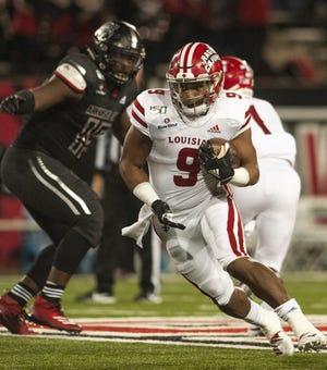 UL running back Trey Ragas runs the ball Thursday against Arkansas State in Jonesboro.