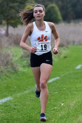 Katie Carothers finished fourth in 18:40.0, leading Brighton to the KLAA girls cross country championship at Huron Meadows Metropark on Tuesday, Oct. 17, 2019.