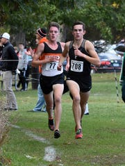 Plymouth's Carter Solomon (708) was first and Brighton's Jack Spamer (77) took second in the KLAA cross country meet at Huron Meadows Metropark on Thursday, Oct. 17, 2019.