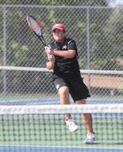 Pinckney's Sebastian Smith won a first-round match at No. 1 singles in the state Division 3 tennis tournament.