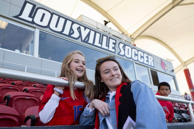 Ashlyn Blackwell, 12, gets a photograph taken with United States National Team soccer player Rose Lavelle at the U of L Lynn Soccer Stadium on Friday before the women's game. Oct. 18, 2019