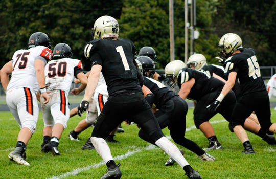 Corunna High School defensive end Nick Steinacker (1) was an all-state selection in 2018.