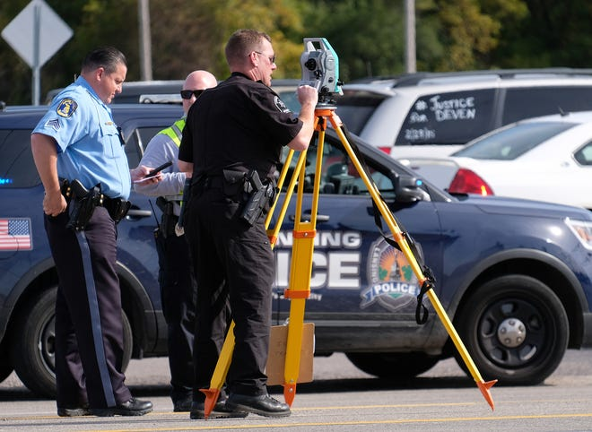 The Lansing Police Department and Ingham County Sheriff Department is at the scene of a crash involving a car and a pedestrian, Friday, Oct. 18, 2019. Police Monday said the pedestrian, Brian Keith Miller, 52, died as a result of the crash.