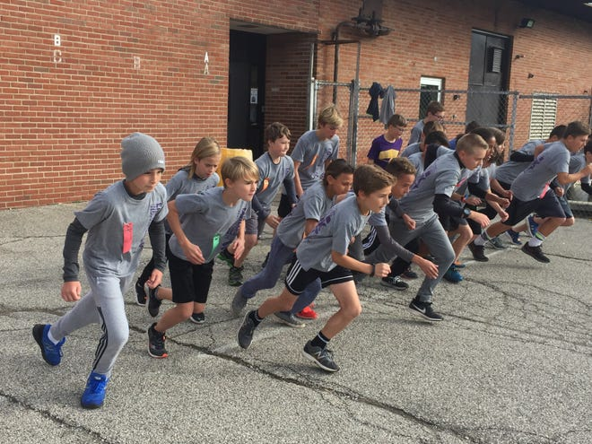 Boys in the running club at Eastern Elementary School in Lexington take off for a 1-mile race.